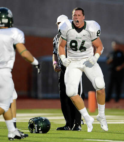 REagan's Tanner Schorp celebrates after making a big tackle during a 26-5A Football game between the Reagan Rattlers and the Madison Mavericks at Heroes Stadium in San Antonio, Saturday, October 13, 2012.