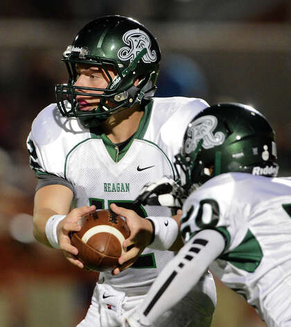 Reagan's Kyle Keller (12) hands off during a 26-5A Football game between the Reagan Rattlers and the Madison Mavericks at Heroes Stadium in San Antonio, Saturday, October 13, 2012.