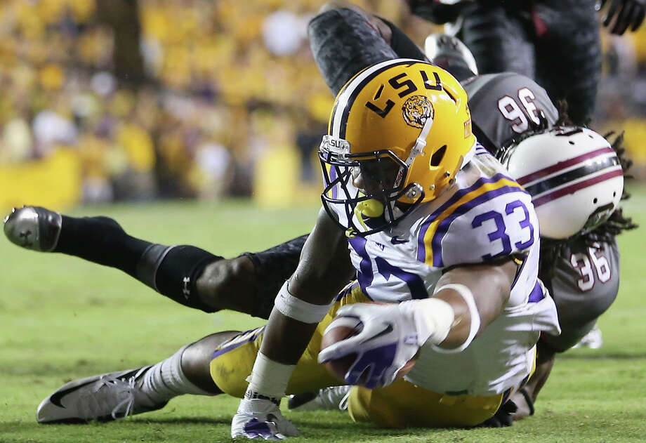 LSU's Jeremy Hill dives for the first of his two touchdowns, a 7-yarder than preceded a 50-yarder. Photo: Ronald Martinez / 2012 Getty Images