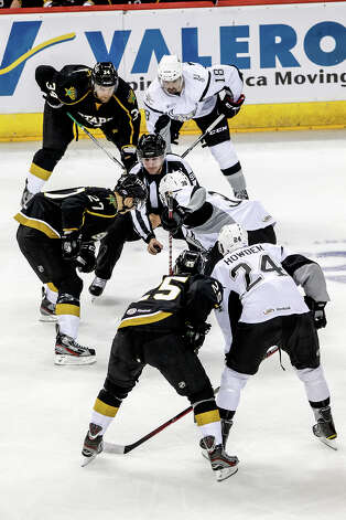 The San Antonio Rampage (right) and Texas Stars put the puck into play during the Rampage's AHL season opener at the AT&T Center on Oct. 13, 2012.  MARVIN PFEIFFER/ mpfeiffer@express-news.net Photo: MARVIN PFEIFFER, Express-News / Express-News 2012