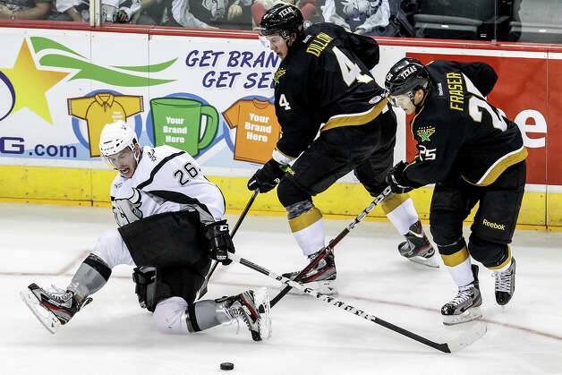 San Antonio Rampage's Jon Rheault ( left) tries to maintain control of the puck as Texas Stars' Brendoen Dillon (center) and Matt Fraser come on during the Rampage's AHL season opener at the AT&T Center on Oct. 13, 2012.  MARVIN PFEIFFER/ mpfeiffer@express-news.net Photo: MARVIN PFEIFFER, Express-News / Express-News 2012