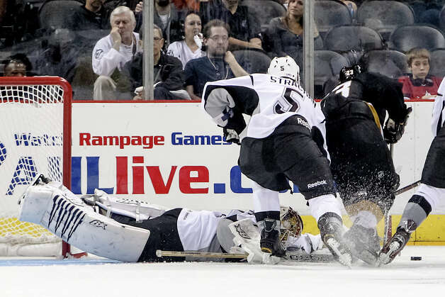 San Antonio Rampage goalie Dov Grumet-Morris dives for the puck during the second period of the Rampage's AHL season opener with the Texas Stars at the AT&T Center on Oct. 13, 2012.  MARVIN PFEIFFER/ mpfeiffer@express-news.net Photo: MARVIN PFEIFFER, Express-News / Express-News 2012