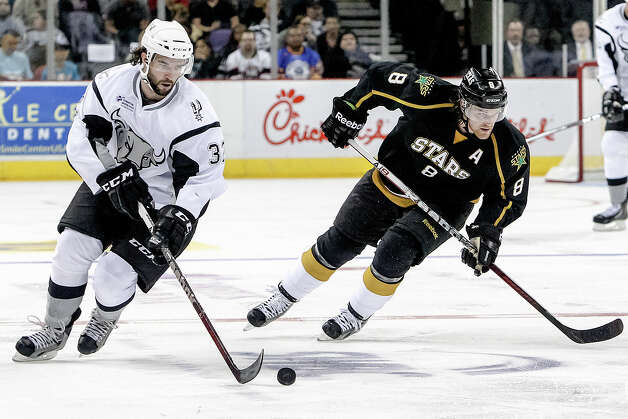 San Antonio Rampage's Scvott Timmins (left) skates ahead of Texas Stars' Patik Jordie Benn during the second period of the Rampage's AHL season opener at the AT&T Center on Oct. 13, 2012.  MARVIN PFEIFFER/ mpfeiffer@express-news.net Photo: MARVIN PFEIFFER, Express-News / Express-News 2012
