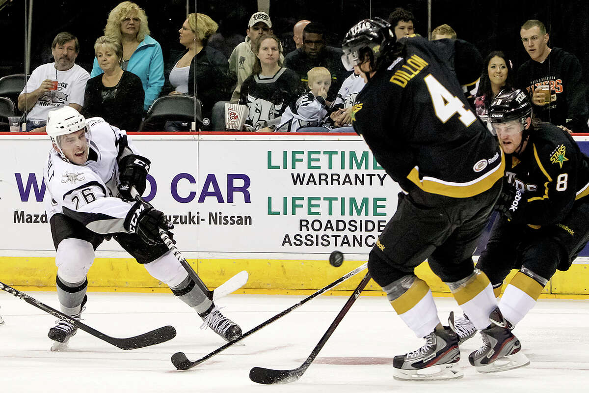 San Antonio Rampage's Jon Rheault (from left) takes a shot on goal past Texas Stars' Brendoen Dillon and Jordie Benn during the second period of the Rampage's AHL season opener at the AT&T Center on Oct. 13, 2012. MARVIN PFEIFFER/ mpfeiffer@express-news.net