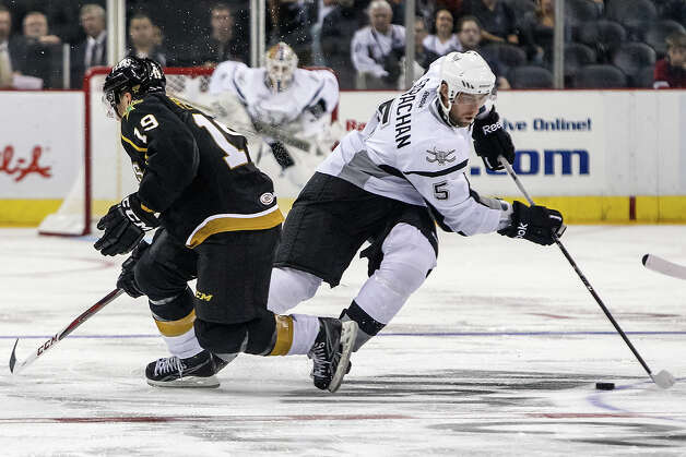 San Antonio Rampage's Tyson Strachan (right) drives the puck past Texas Stars' Toby Petersen during the second period of the Rampage's AHL season opener with the Texas Stars at the AT&T Center on Oct. 13, 2012.  MARVIN PFEIFFER/ mpfeiffer@express-news.net Photo: MARVIN PFEIFFER, Express-News / Express-News 2012