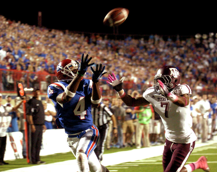 Louisiana Tech's Quinton Patton, left, catches a pass for a touchdown during an NCAA college football game against Texas A&M in Shreveport, La., Saturday, Oct. 13, 2012. (AP Photo/Kita K Wright) Photo: Kita K Wright, Associated Press / FR156206 AP