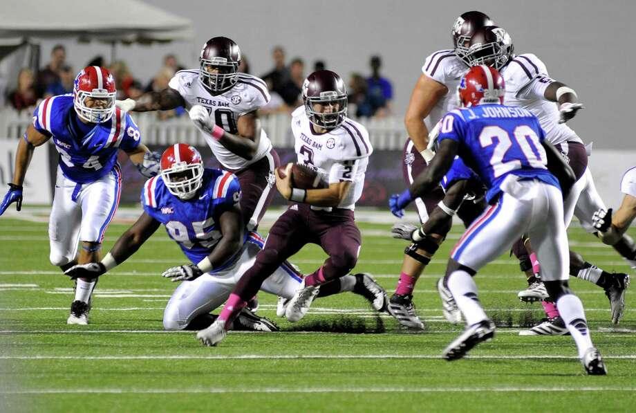 Texas A&M quarterback Johnny Manziel (2) scrambles for yards during an NCAA college football game against Louisiana Tech in Shreveport, La., Saturday, Oct. 13, 2012. (AP Photo/Kita K Wright) Photo: Kita K Wright, Associated Press / FR156206 AP