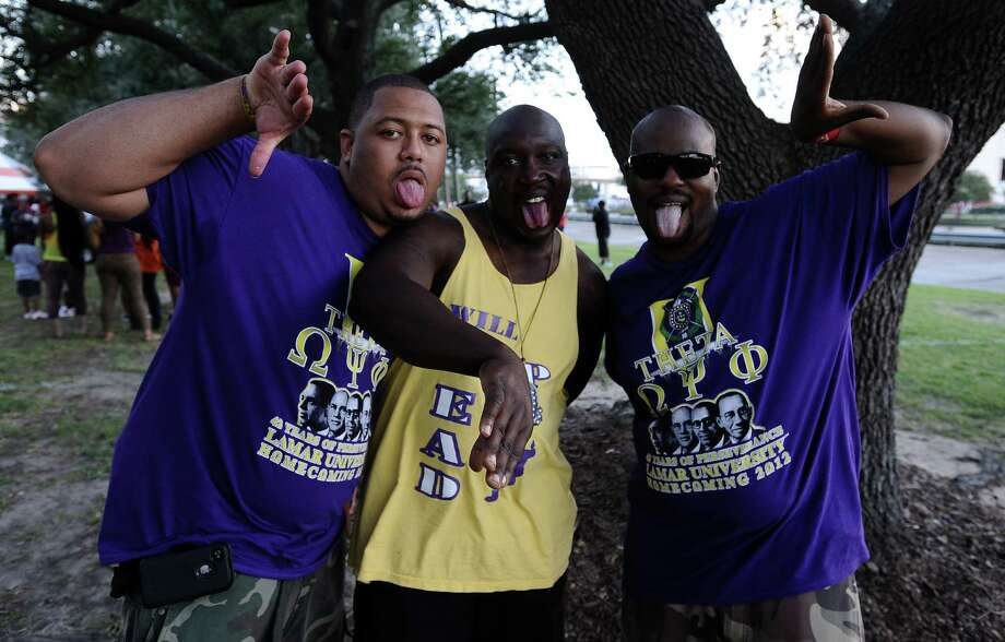 Lamar alumni Jason Rufus, left, '07 and Michael Fregia, right, '11 celebrate Lamar University Homecoming with Omega Psi Phi fraternity brother Willie Evans, center,at Provost Umphrey Stadium on Saturday, October 13, 2012. Photo taken: Randy Edwards/The Enterprise