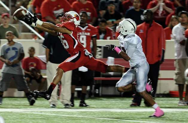 Lamar wide receiver Jordan Edwards just can not get his hands on the ball during Lamar University football game against McMurry University at Provost Umphrey Stadium on Saturday, October 13, 2012. Photo taken: Randy Edwards/The Enterprise