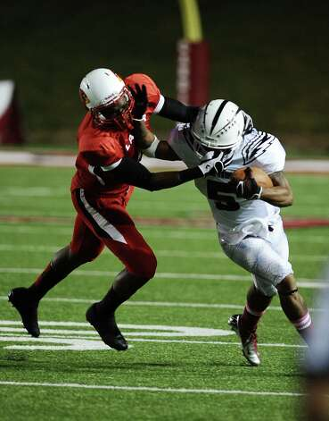 McMurry running back Paxton Grayer is face masked by an offensive player from Lamar during Lamar University football game against McMurry University at Provost Umphrey Stadium on Saturday, October 13, 2012. Photo taken: Randy Edwards/The Enterprise