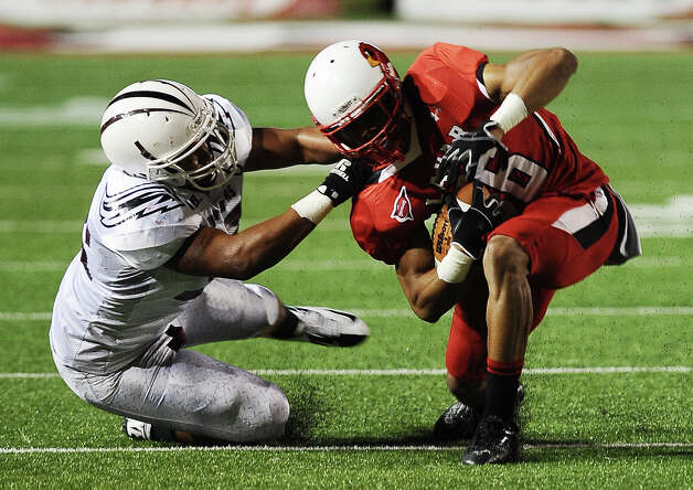 Lamar wide receiver Jordan Edwards is tackled by McMurry defensive player during Lamar University football game against McMurry University at Provost Umphrey Stadium on Saturday, October 13, 2012. Photo taken: Randy Edwards/The Enterprise