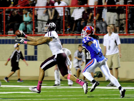 A&M 59, La. Tech 57Texas A&M's Mike Evans, left, catches a 75-yard touchdown pass against Louisiana Tech during an NCAA college football game in Shreveport, La., Saturday, Oct. 13, 2012. (AP Photo/Kita K Wright) Photo: Kita K Wright, Associated Press / FR156206 AP