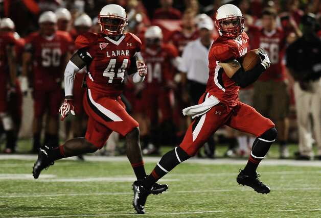 Lamar  wide receiver Kevin Johnson runs a kick off back in the first quarter for a touchdown during Lamar University football game against McMurry University at Provost Umphrey Stadium on Saturday, October 13, 2012. Photo taken: Randy Edwards/The Enterprise
