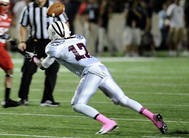 McMurry defensive back Gregory Pinckney intercepts a pass in the second quarter during Lamar University football game against McMurry University at Provost Umphrey Stadium on Saturday, October 13, 2012. Photo taken: Randy Edwards/The Enterprise Photo taken: Randy Edwards/The Enterprise