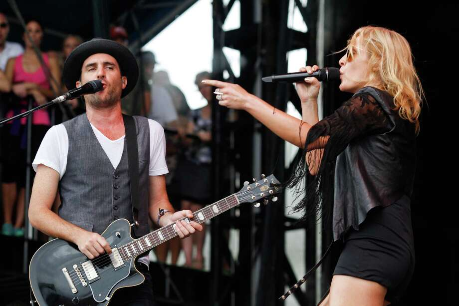 Metric's Emily Haines, left, and James Shaw perform at the Austin City Limits Music Festival, Saturday, Oct. 13, 2012, in Austin, Texas.(Photo by Jack Plunkett/Invision/AP) Photo: Jack Plunkett, Associated Press / Invision