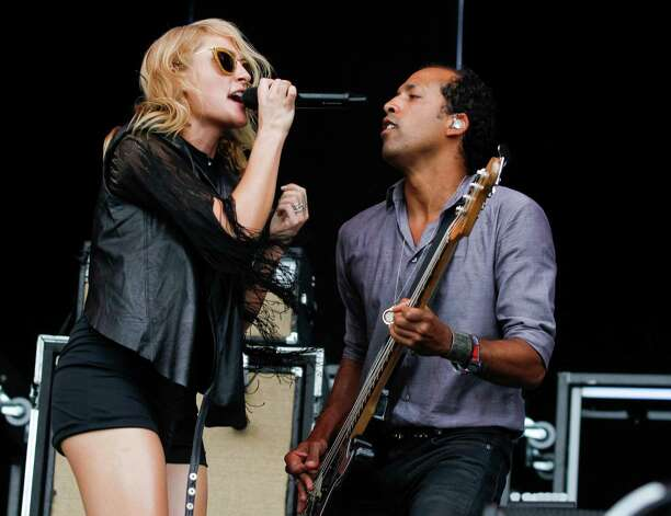 Metric's Emily Haines, left, and Joshua Winstead perform at the Austin City Limits Music Festival, Saturday, Oct. 13, 2012, in Austin, Texas.(Photo by Jack Plunkett/Invision/AP) Photo: Jack Plunkett, Associated Press / Invision