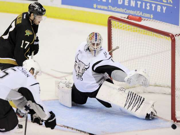 San Antonio Rampage goaltender Dov Grumet-Morris, right, makes a save on Texas Stars' Tomas Vincour (17) during the third period of an AHL hockey game, Saturday, Oct. 13, 2012, in San Antonio. Texas won 2-1. (Darren Abate/pressphotointl.com) Photo: Darren Abate, Express-News / Darren Abate/pressphotointl.com