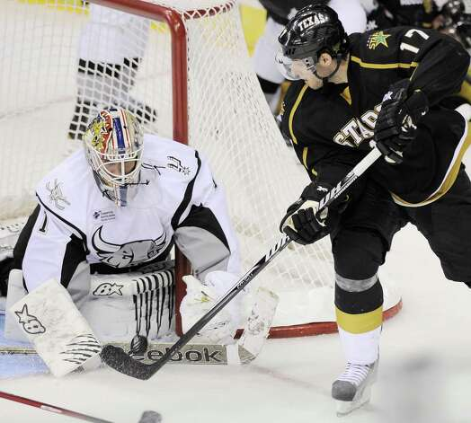 San Antonio Rampage goaltender Dov Grumet-Morris, left, makes a save on Texas Stars' Tomas Vincour (17) during the third period of an AHL hockey game, Saturday, Oct. 13, 2012, in San Antonio. Texas won 2-1. (Darren Abate/pressphotointl.com) Photo: Darren Abate, Express-News / Darren Abate/pressphotointl.com