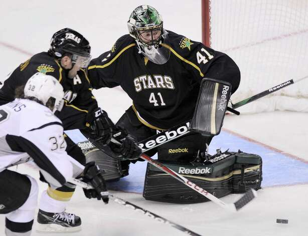 Texas Stars goaltender Cristopher Nilstorp (41) makes a save on San Antonio Rampage's Scott Timmins during the second period of an AHL hockey game, Saturday, Oct. 13, 2012, in San Antonio. (Darren Abate/pressphotointl.com) Photo: Darren Abate, Express-News / Darren Abate/pressphotointl.com