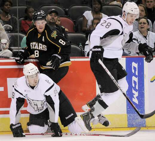 San Antonio Rampage's Justin Vaive, left, and Texas Stars' Jordie Benn (8) collide along the boards as Rampage's James Wright jumps to avoid them during the first period of an AHL hockey game, Saturday, Oct. 13, 2012, in San Antonio. Texas won 2-1. (Darren Abate/pressphotointl.com) Photo: Darren Abate, Express-News / Darren Abate/pressphotointl.com