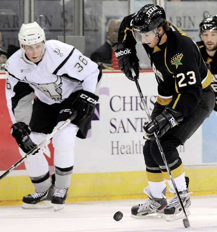 Texas Stars' Travis Morin (23) evades San Antonio Rampage's Drew Shore during the first period of an AHL hockey game, Saturday, Oct. 13, 2012, in San Antonio. (Darren Abate/pressphotointl.com) Photo: Darren Abate, Express-News / Darren Abate/pressphotointl.com