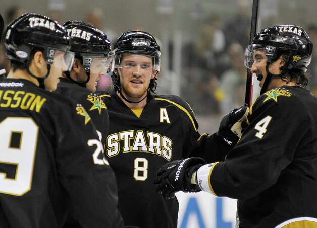 Texas Stars' Jordie Benn (8) celebrates a goal with teammates during the first period of an AHL hockey game against the San Antonio Rampage, Saturday, Oct. 13, 2012, in San Antonio. (Darren Abate/pressphotointl.com) Photo: Darren Abate, Express-News / Darren Abate/pressphotointl.com