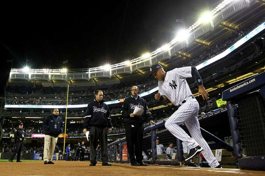 NEW YORK, NY - OCTOBER 13:  Derek Jeter #2 of the New York Yankees runs out to the field during introductions against the Detroit Tigers during Game One of the American League Championship Series at Yankee Stadium on October 13, 2012 in the Bronx borough of New York City, New York.  (Photo by Al Bello/Getty Images) Photo: Al Bello