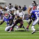Texas A&M quarterback Johnny Manziel (3) scrambles for yards during an NCAA college football game against Louisiana Tech in Shreveport, La., Saturday, Oct. 13, 2012. (AP Photo/Kita K Wright)