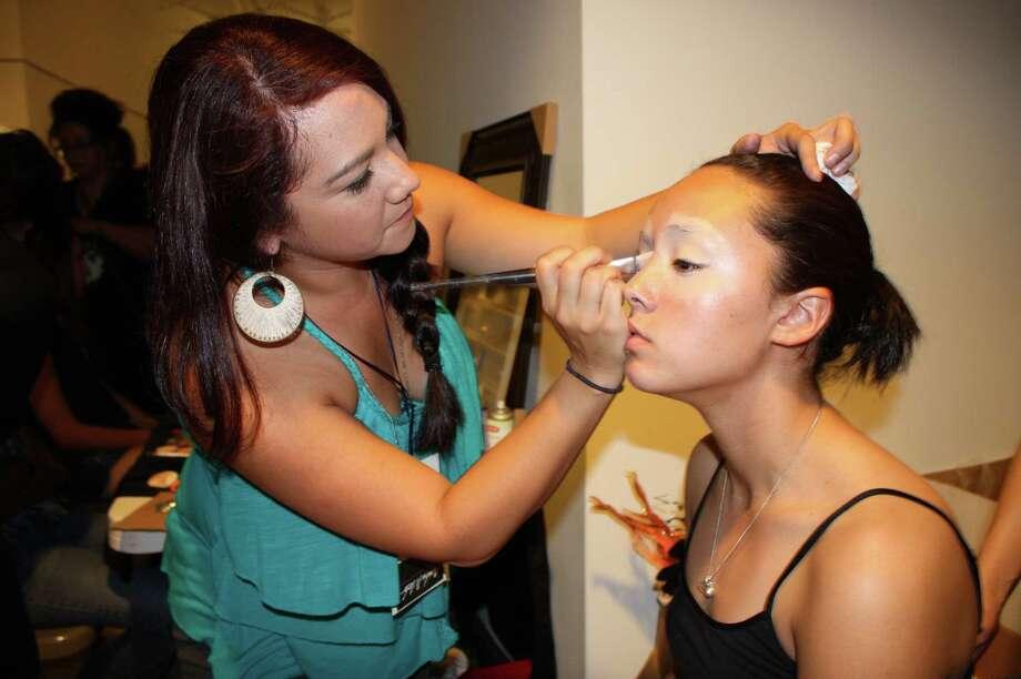 People check out fashion, music and art at Una Noche de la Gloria at the Guadalupe Cultural Arts Center on Saturday, Oct. 13, 2012. Photo: Yvonne Zamora, MySA.com