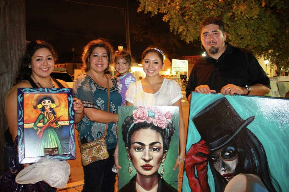 People check out fashion, music and art at Una Noche de la Gloria at the Guadalupe Cultural Arts Center on Saturday, Oct. 13, 2012. Photo: Yvonne Zamora, MySA.com