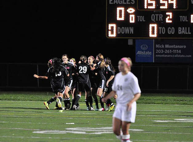 Fairfield Warde celebrates Jenn Maldenado's goal during the Mustangs' 1-0 win over Trumbull on Thursday in Trumbull. Photo: Contributed Photo