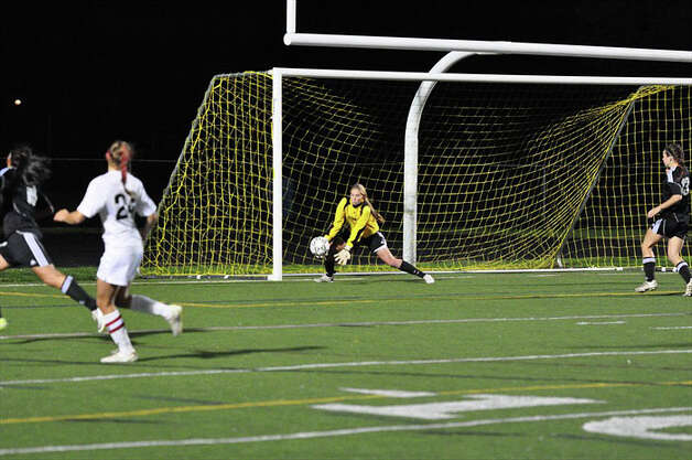 Fairfield Warde goalkeeper Katie Brennan scoops up a save during the Mustangs' 1-0 win over Trumbull on Thursday in Trumbull. Photo: Contributed Photo