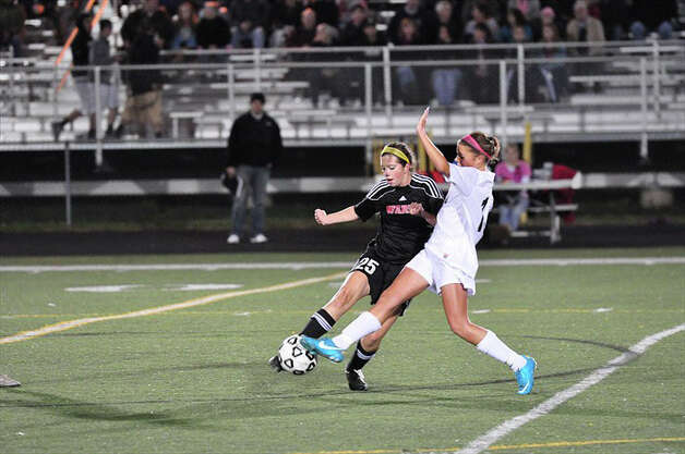 Fairfield Warde's Megan Overby defends a Trumbull player during the Mustangs' 1-0 win over the Eagles on Thursday in Trumbull. Photo: Contributed Photo