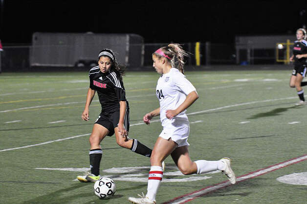 Fairfield Warde defender Julia Delaney cuts off Trumbull's Ana Tantum during the Mustangs' 1-0 win over the Eagles on Thursday in Trumbull. Photo: Contributed Photo