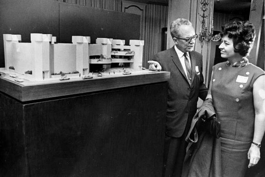 Francis Deering, left, and Houston Chronicle Fine Arts Editor Ann Holmes with a model of the new Alley Theatre building. Published Aug. 3, 1965.  (Houston Chronicle)