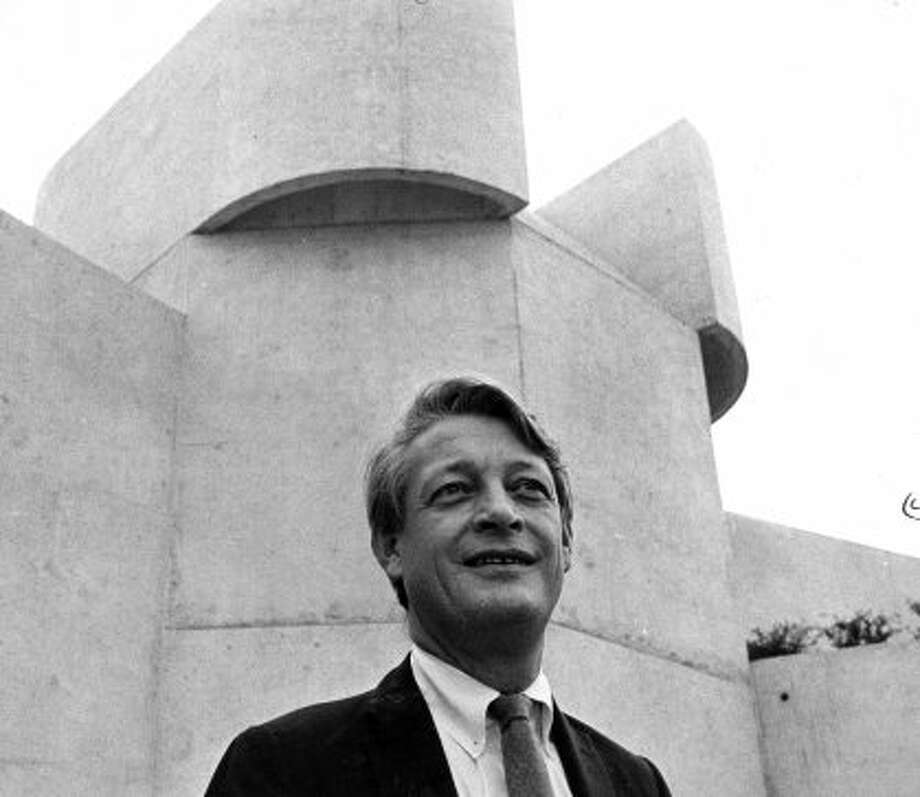 Ulrich Franzen is framed by a tower of the theatre he conceived as prime architect. Published Nov. 24, 1968. (Houston Chronicle)