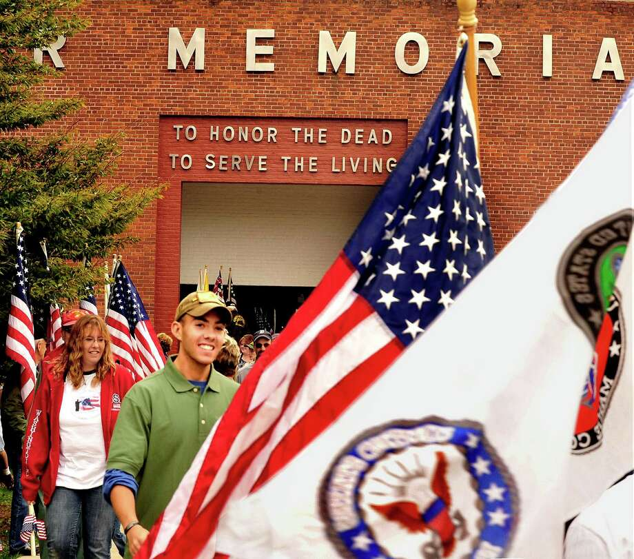 Todd Angell, recipient of the Warrior Award, leads the Walk of Honor from the Danbury War Memorial Sunday, Oct. 14, 2012. Photo: Michael Duffy