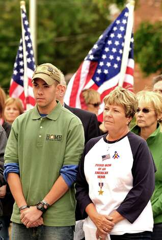 Todd Angel and his mom, Mary Angell,stand together during the Walk of Honor ceremony at the Danbury War Memorial Sunday, Oct. 14, 2012. Photo: Michael Duffy