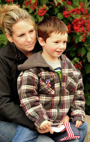 Denise Blais holds Charlie Pankenier, 4, during the Walk of Honor ceremony at the Danbury War Memorial Sunday, Oct. 14, 2012. Photo: Michael Duffy