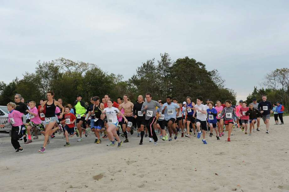 The beginning of Susannah's Run, a 5K and half-mile run at Greenwich Point, Sunday, Oct. 14, 2012. The event supported the Susannah Chase Memorial Scholarship Fund and celebrates the late Susannah Chase's love of the outdoors and dedication to running. Other upcoming races are the Beachfront Bushwhack/Max's Mile at 9:30 a.m. on Nov. 11, and the Jingle Bell Jog at 9 a.m. Dec. 9. Photo: Helen Neafsey / Greenwich Time