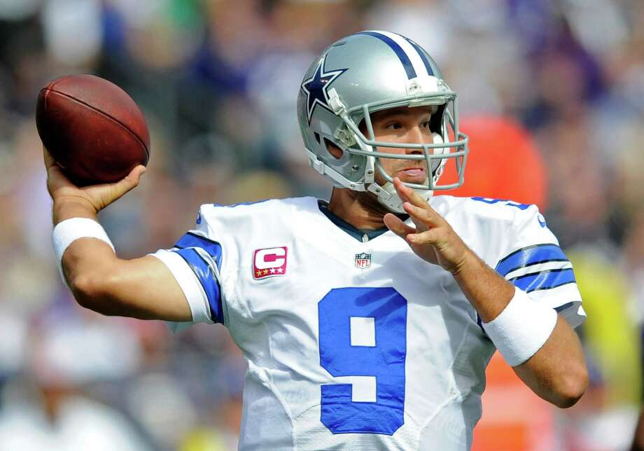 Dallas Cowboys quarterback Tony Romo throws to a receiver in the first half of an NFL football game against the Baltimore Ravens in Baltimore, Sunday, Oct. 14, 2012. (AP Photo/Nick Wass) Photo: Nick Wass / FR67404 AP