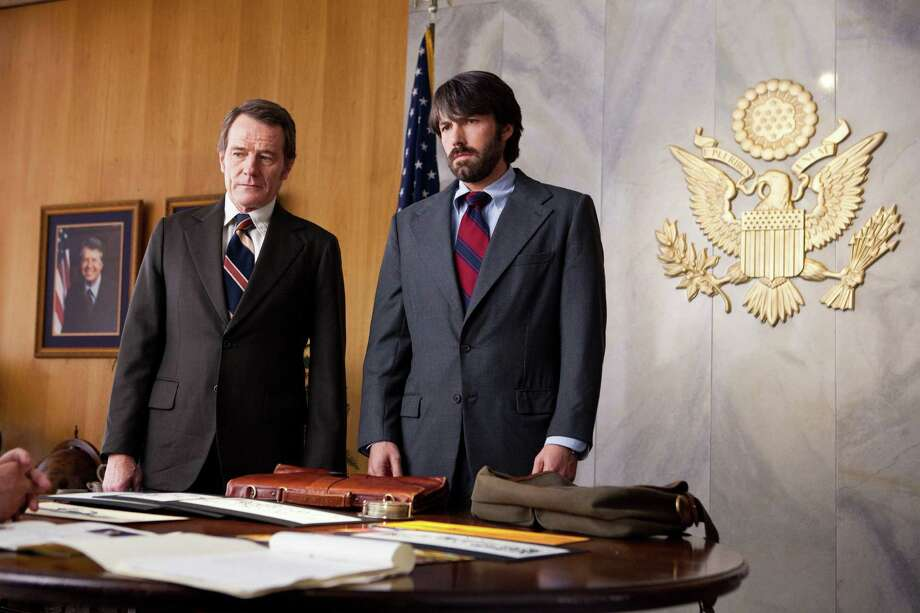 """This film image released by Warner Bros. Pictures shows Bryan Cranston, left, as Jack O'Donnell and Ben Affleck as Tony Mendez in """"Argo,""""  a rescue thriller about the 1979 Iranian hostage crisis. (AP Photo/Warner Bros., Claire Folger) Photo: Claire Folger"""