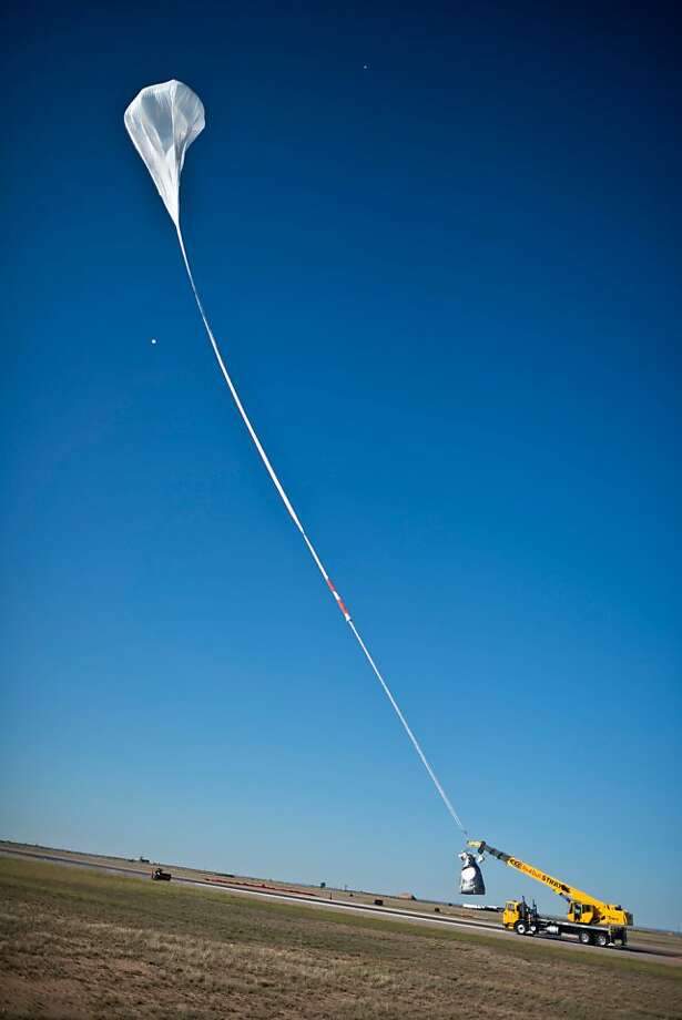 A crane launching the capsule during the final manned flight for Red Bull Stratos in Roswell, New Mexico, USA on October 14, 2012. Daredevil Felix Baumgartner lifted off from the New Mexico desert on Sunday, in his second attempt to make a record-breaking jump from the edge of space. Baumgartner was being transported up to 23 miles (37 kilometers) above the Earth by an enormous balloon, before launching himself into the void, aiming to become the first human to break the sound barrier in freefall.The capsule rose into the clear blue sky, with organizers holding their breath for the first few thousand feet of ascent, as Baumgartner would not have had enough time to escape had there been a problem. Photo: Jorg Mitter, AFP/Getty Images