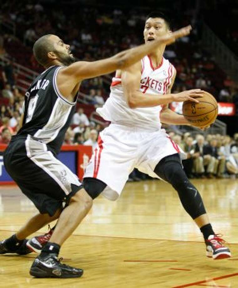 Rockets Jeremy Lin (7) drives the ball against Spurs Tony Parker (9) during the first  half of an NBA basketball game, Sunday, Oct. 14, 2012, in Houston. (AP Photo/Eric Kayne) (Associated Press)