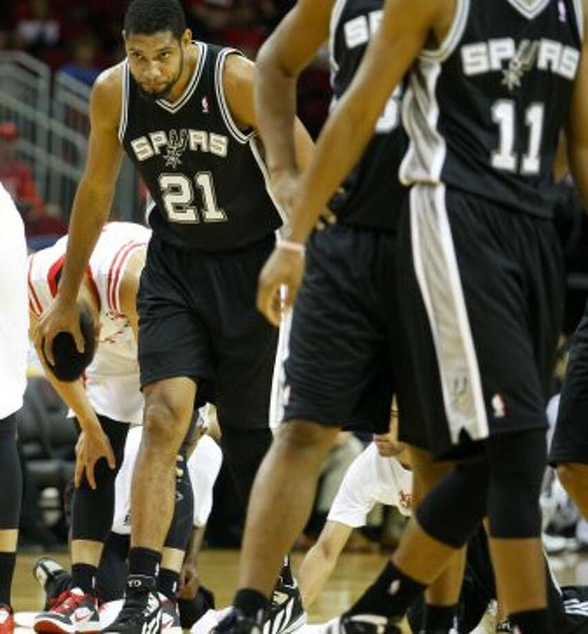 Rockets Jeremy Lin (7) has his head touched by Spurs Tim Duncan (21) after they scrambled for a ball during the first  half of an NBA basketball game, Sunday, Oct. 14, 2012, in Houston. (AP Photo/Eric Kayne) (Associated Press)