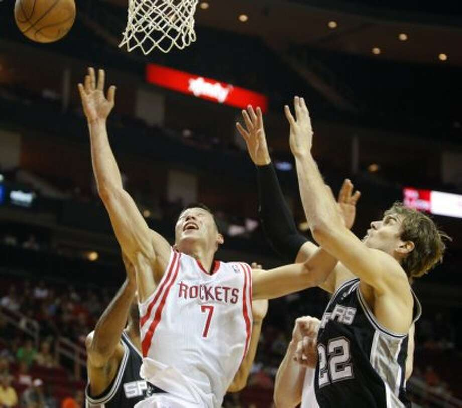 Rockets Jeremy Lin (7) shoots while defended by Spurs Tiago Splitter  (22) during the first  half of an NBA basketball game, Sunday, Oct. 14, 2012, in Houston. (AP Photo/Eric Kayne) (Associated Press)