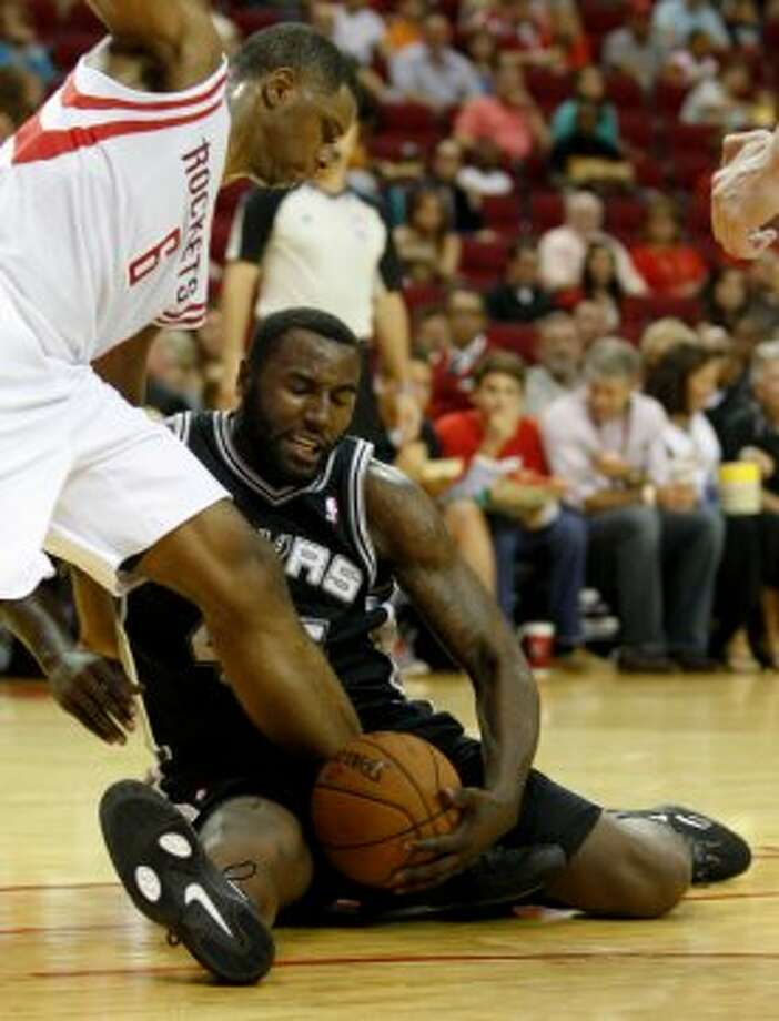 San Antonio Spurs DeJuan Blair (45) attempts to gain control of the ball against Houston Rockets Terrence Jones (6) during the second half of an NBA basketball game, Sunday, Oct. 14, 2012, in Houston. Spurs won 116-107. (AP Photo/Eric Kayne) (Associated Press)