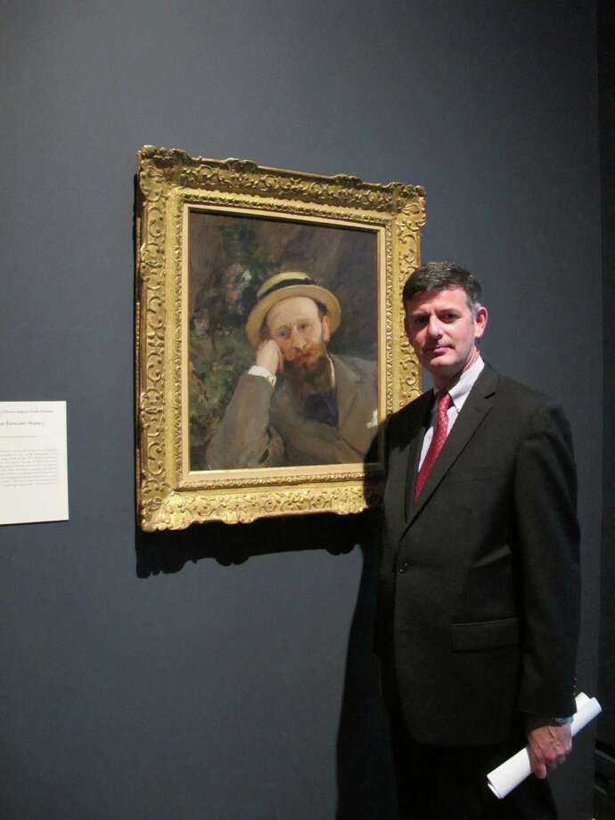 Brian Kennedy, director of the Toledo Museum of Art, poses in front of a portrait of French Impressionist Edouard Manet, Wednesday, Oct. 3, 2012, in Toledo, Ohio. An exhibition of Manet's works opened this month and runs through the end of the year before moving onto the Royal Academy of Arts in London.  (AP Photo/John Seewer) Photo: John Seewer