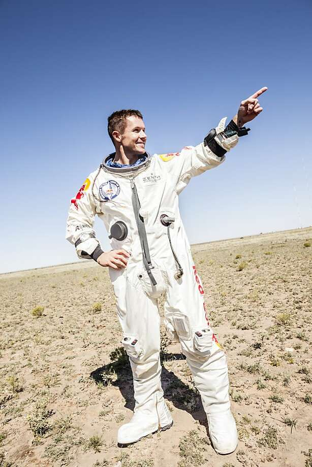 This picture provided by www.redbullcontentpool.com shows pilot Felix Baumgartner of Austria celebrating after successfully completing the final manned flight for Red Bull Stratos in Roswell, New Mexico, on October 14, 2012. The Austrian daredevil became the first man to break the sound barrier in a record-shattering freefall jump from the edge of space, organizers said. The 43-year-old leapt from a capsule more than 24 miles (39 kilometers) above the Earth, reaching a speed of 706 miles per hour (1,135 km/h) before opening his red and white parachute and floating down to the New Mexico desert.  Photo: Balazs Gardi, AFP/Getty Images