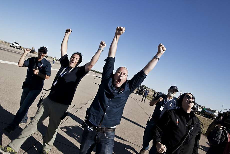 This picture provided by www.redbullcontentpool.com crew members celebrating the successful launch during the final manned flight for Red Bull Stratos in Roswell, New Mexico, USA on October 14, 2012. Daredevil Felix Baumgartner lifted off from the New Mexico desert on Sunday, in his second attempt to make a record-breaking jump from the edge of space.Baumgartner was being transported up to 23 miles (37 kilometers) above the Earth by an enormous balloon, before launching himself into the void, aiming to become the first human to break the sound barrier in freefall.The capsule rose into the clear blue sky, with organizers holding their breath for the first few thousand feet of ascent, as Baumgartner would not have had enough time to escape had there been a problem. Photo: Balazs Gardi, AFP/Getty Images
